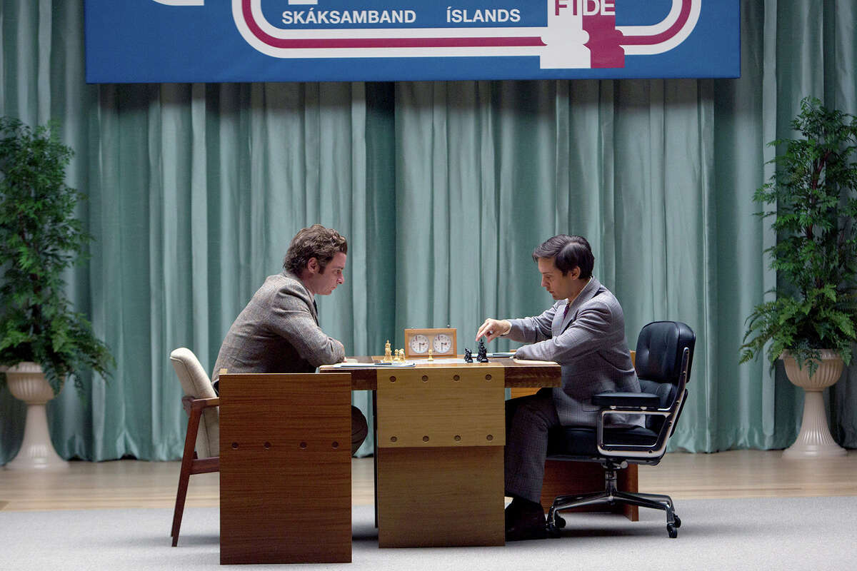 """Liev Schreiber, left, and Tobey Maguire star in """"Pawn Sacrifice."""""""