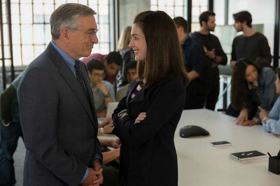 "Robert De Niro and Anne Hathaway play co-workers in ""The Intern."" Photo: Warner Bros Entertainment, HO / Chicago Tribune"