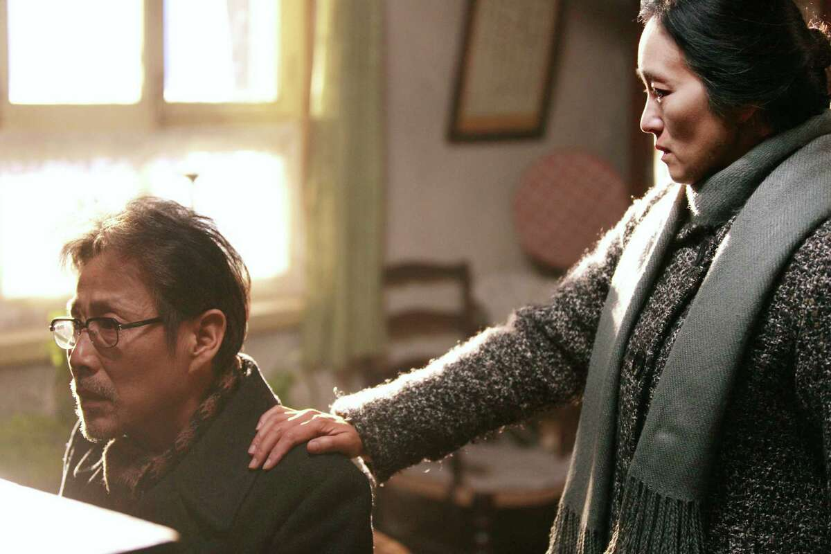 Left to right: Lu Yanshi (Chen Daoming, left) and Feng Wanyu (Gong Li) are a husband and wife in post-Cultural Revolutionary China in Zhang Yimou's
