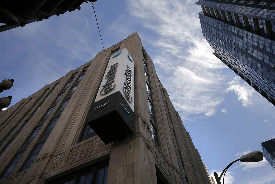 Old and new the Merchandise Mart Building, (left) is home to Twitter along Market St. at 10th in San Francisco, Calif. on Thurs. September 24, 2015. Photo: Michael Macor, The Chronicle
