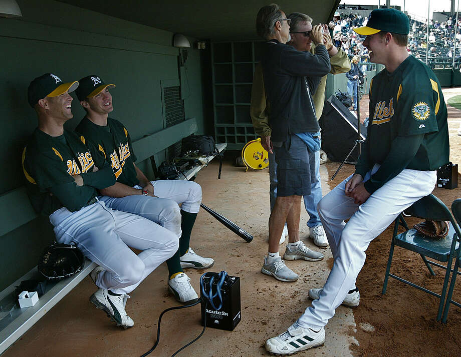 Tim Hudson (from left), Barry Zito and Mark Mulder laugh after finishing a Sports Illustrated photo shoot at spring training in Phoenix in 2004. Photo: Deanne Fitzmaurice / San Francisco Chronicle / San Francisco Chronicle