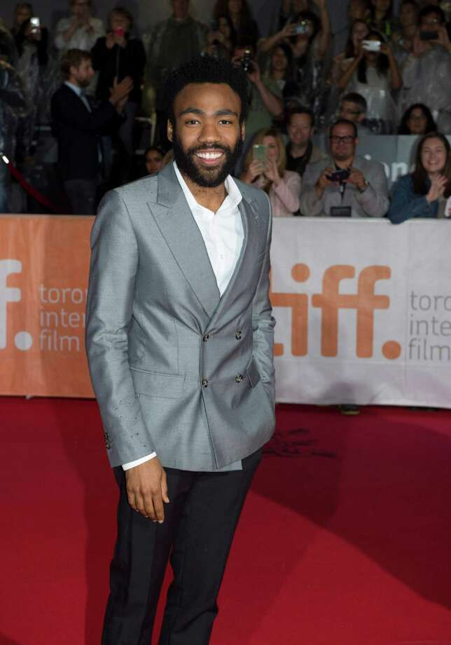 "CAPTION CORRECTION, CORRECTS NAME TO DONALD GLOVER, INSTEAD OF CHIWETEL EJIOFOR Donald Glover arrives on the red carpet at the gala for the film ""The Martian"" at the 2015 Toronto International Film Festival in Toronto on Friday, Sept. 11, 2015.  (Frank Gunn/The Canadian Press via AP) ORG XMIT: FNG304 Photo: Frank Gunn / The Canadian Press"