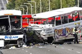 The aftermath of a wreck involving a Ride the Ducks vehicle and a charter bus on Seattle's Aurora Bridge on Sept. 24, 2015. (Joshua Trujillo/seattlepi.com)