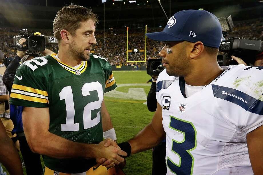 Quarterbacks Aaron Rodgers #12 of the Green Bay Packers and Russell Wilson #3 of the Seattle Seahawks shake hands following the NFL game at Lambeau Field on September 20, 2015 in Green Bay, Wisconsin. The Packers defeated the Seahawks 27-17. Photo: Christian Petersen, Getty Images / 2015 Getty Images