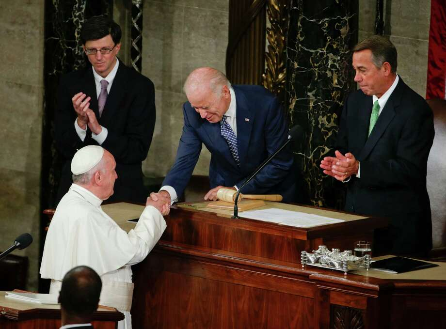 Vice President Joe Biden shakes hands with Pope Francis on Capitol Hill in Washington, Thursday, Sept. 24, 2015, prior to the pope's address to a joint meeting of Congress, making history as the first pontiff to do so. House Speaker John Boehner of Ohio is at right. (AP Photo/Pablo Martinez Monsivais) Photo: Pablo Martinez Monsivais, STF / Associated Press / AP