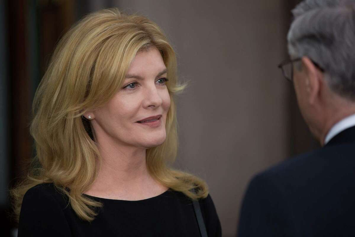 """This photo provided by Warner Bros. Pictures shows Rene Russo, left, as Fiona, and Robert De Niro as Ben Whittaker, in a scene from the comedy, """"The Intern,"""" a Warner Bros. Pictures release. (Francois Duhamel/Warner Bros. Pictures via AP) ORG XMIT: CAET330"""