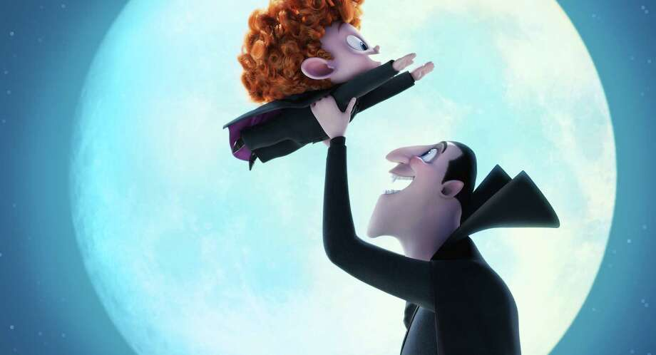 "This image released by Sony Pictures Animation shows Dennis, voiced by Asher Blinkoff, left, and Dracula, voiced by Adam Sandler, in a scene from in Columbia Pictures and Sony Pictures Animation's ""Hotel Transylvania 2."" (Sony Pictures Animation via AP) ORG XMIT: NYET117 Photo: Sony Pictures Animation / Sony Pictures Animation"