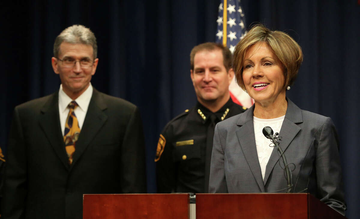 San Antonio City Manager Sheryl Scully announces that former San Antionio Police Chief William McManus (far left) will resume his position as police chief. Interim police chief Anthony Trevino (center) took over as chief when McManus departed the department last year. A reader disagrees with the reappointment, saying it is time for new blood.
