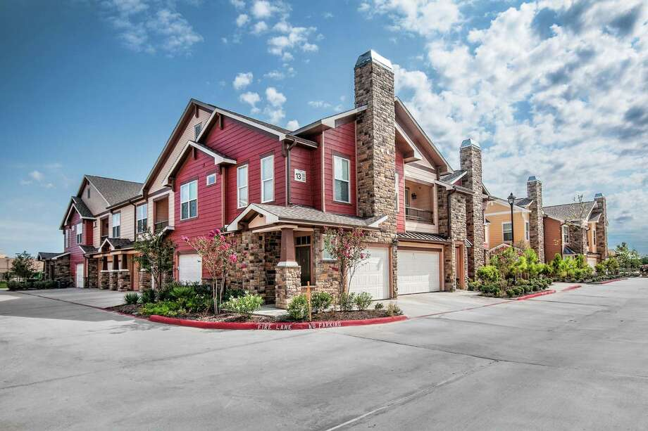 """This is an example of The Garrett Cos.' """"Big House"""" for-rent concept that the Indianapolis developer is planning for Cable Ranch Road on the far West Side. The 240-unit, 21-building apartment complex is the company's first in San Antonio. Photo: The Garrett Cos. / RON JACKSON ARTISTRY"""