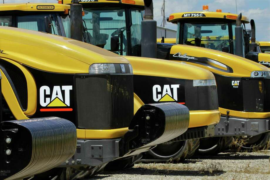 Caterpillar said it will cut 10,000 salaried and management jobs in several phases as part of a wider push to eliminate $1.5 billion in annual costs.. (AP Photo/Seth Perlman, File) Photo: Seth Perlman, STF / AP