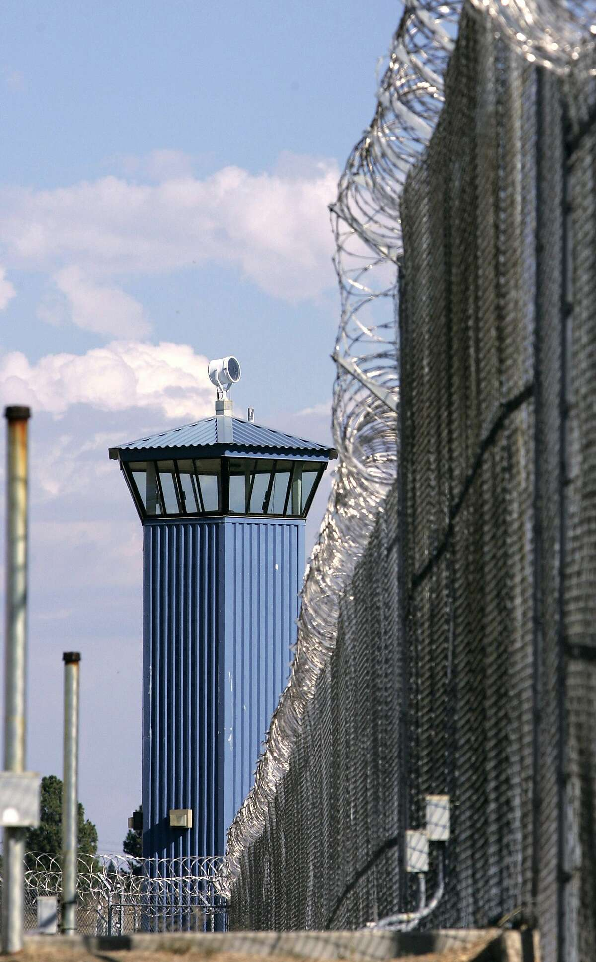 FILE - In this Aug. 31, 2007 file photo, a guard tower stands behind the wire fence that surrounds California State Prison, Sacramento, in Folsom, Calif. Corrections officials say one inmate is dead and several others have been taken to an outside hospital to be treated for stab winds after a riot broke out at one of the prison's exercise yard, Wednesday, Aug. 12, 2015.(AP Photo/Rich Pedroncelli, File)