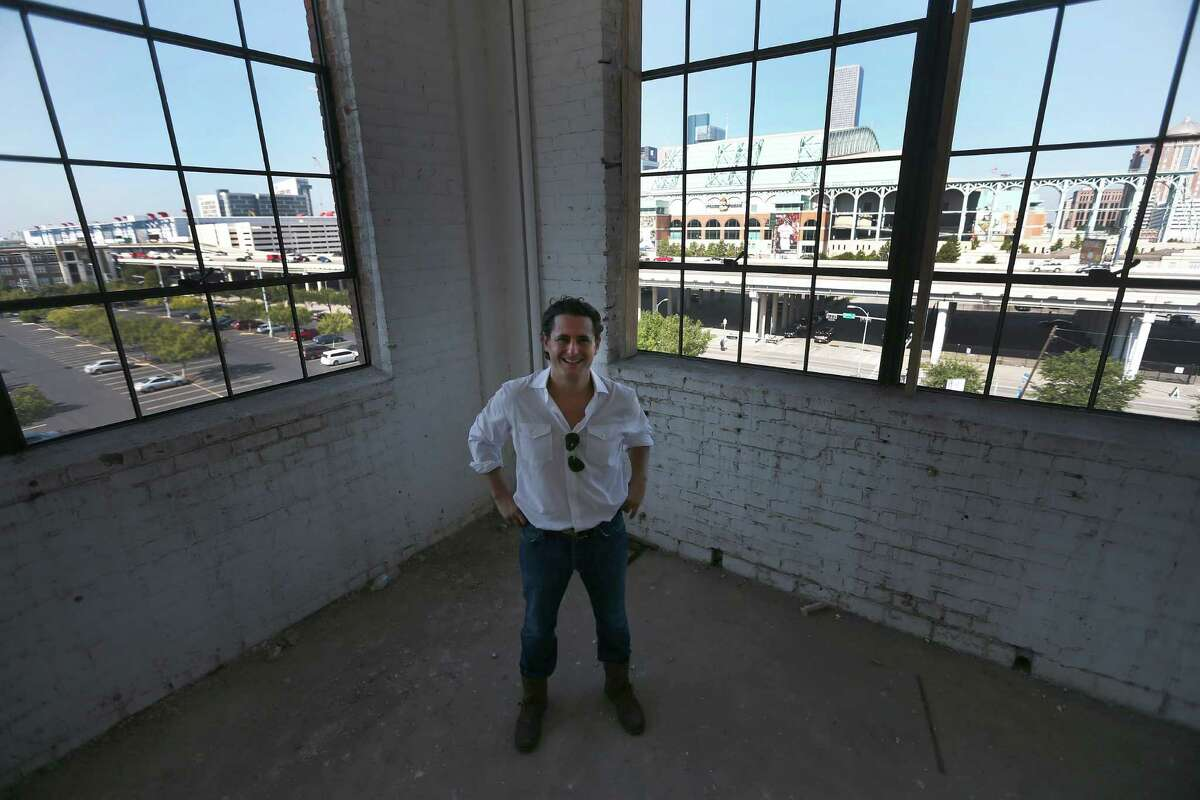 David Denenburg, one of the new owners of the historic Cheek-Neal Coffee building at 2017 Preston, photographed inside of the building with Minute Maid Park in the background.