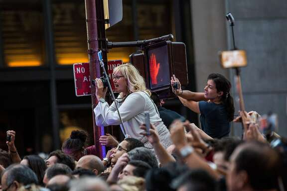 NEW YORK, NY - SEPTEMBER 24:  Crowds cheer as Pope Francis drives down 5th Avenue while on his way to St. Patrick's Cathedral on September 24, 2015 in New York City.  The Pope will offer evening prayers tonight at St. Patrick's Cathedral.  (Photo by Andrew Burton/Getty Images)