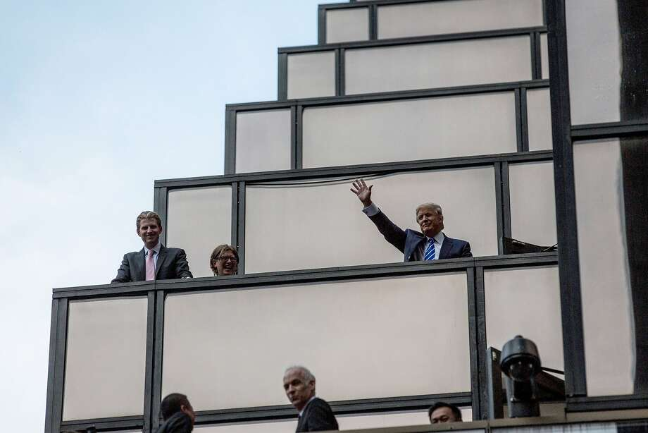 Presidential candidate Donald Trump waves to the crowds waiting for Pope Francis to arrive on 5th Avenue on September 24, 2015 in New York City.  The Pope will offer evening prayers tonight at St. Patrick's Cathedral.  Photo: Andrew Burton, Getty Images