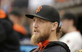 San Francisco Giants right fielder Hunter Pence in the dugout during their baseball game against the San Diego Padres Saturday, Sept. 12, 2015, in San Francisco. (AP Photo/Eric Risberg)