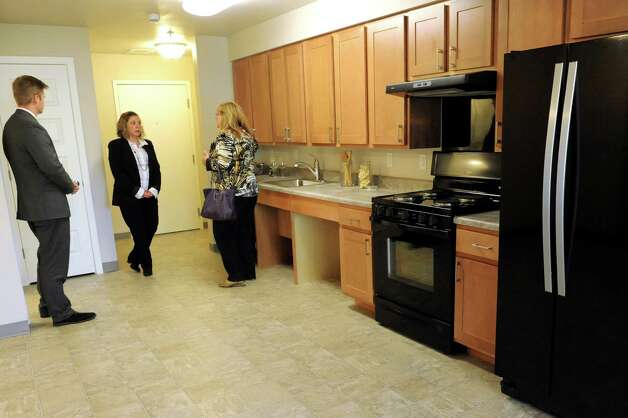 Guests tour a studio apartment on Thursday, Sept. 24, 2015, at the Livingston School Apartments in Albany, N.Y. (Cindy Schultz / Times Union) Photo: Cindy Schultz / 00033472A