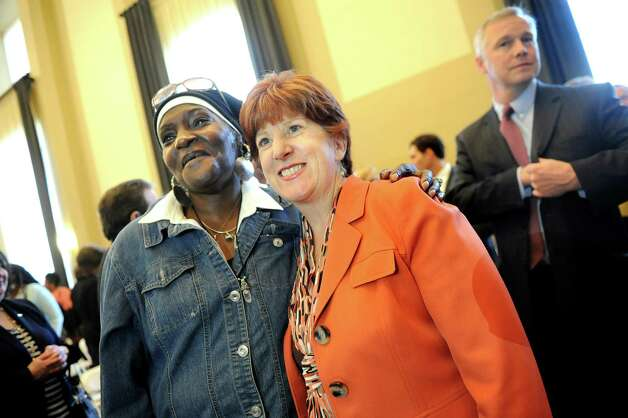 Mayor Kathy Sheehan, center, and resident Joan Parker, left, pose for a picture on Thursday, Sept. 24, 2015, at the Livingston School Apartments in Albany, N.Y. (Cindy Schultz / Times Union) Photo: Cindy Schultz / 00033472A