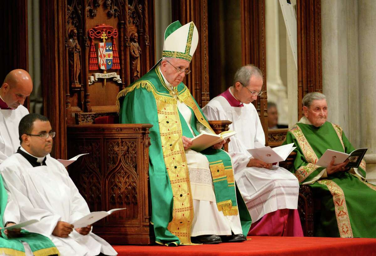 Pope Francis, center, leads an evening prayer service at St. Patrick's Cathedral, Thursday, Sept. 24, 2015, in New York. (Robert Deutsch/USA Today via AP, Pool)