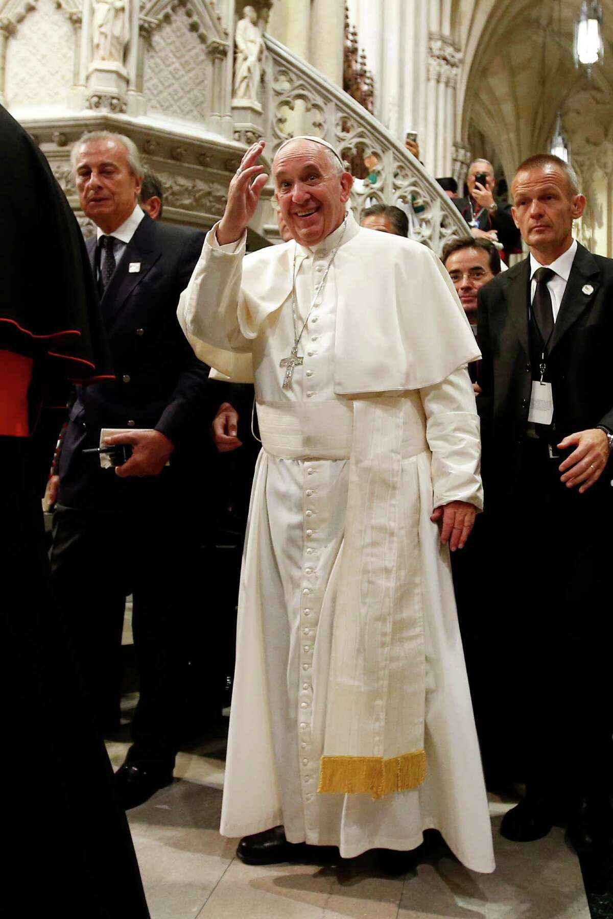 Pope Francis, center, waves as he leaves after leading an evening prayer service at St. Patrick's Cathedral, Thursday, Sept. 24, 2015, in New York.