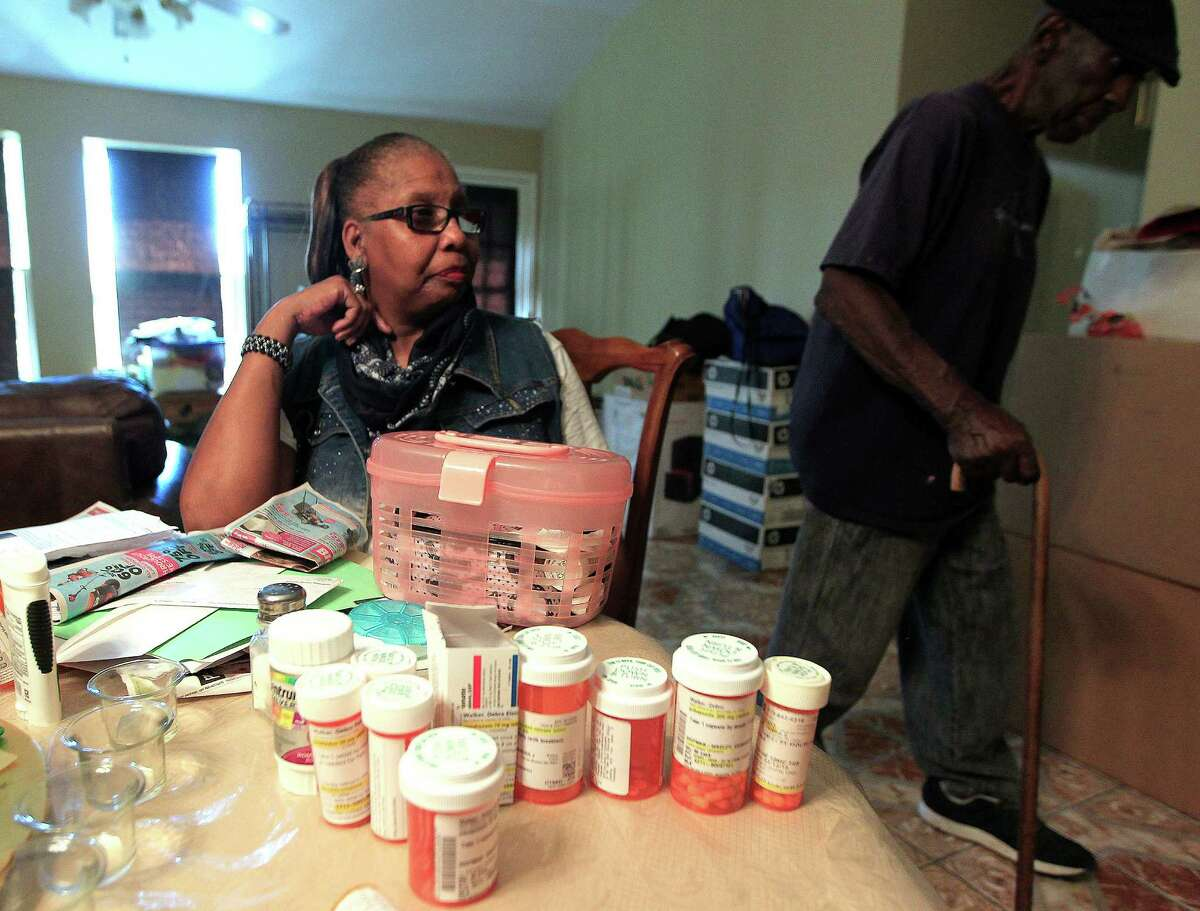 Debra Walker, a patient of Harris Health system, said changes in the agency's rules for subsidized care eligibility will affect her and her husband, Otis, who has prostate cancer.