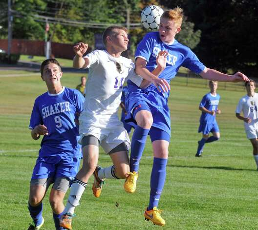 Ballston Spa's Ethan Thomas, center, battles Shaker's Matthew Riccio, left, and Jack Murray for the ball during their boy's soccer game on Thursday Sept. 24, 2015 in Ballston Spa, N.Y.  (Michael P. Farrell/Times Union) Photo: Michael P. Farrell / 00033475A