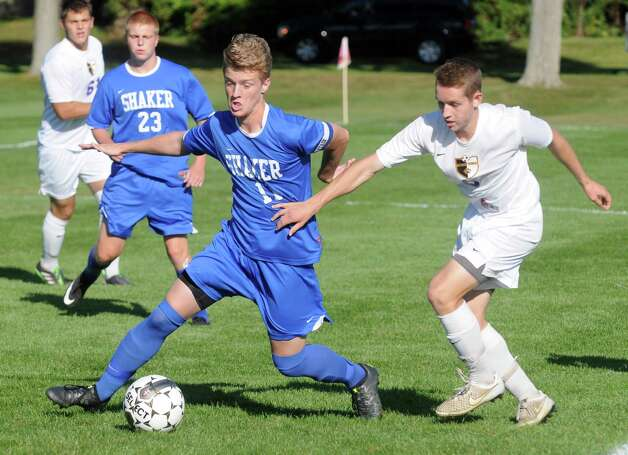 Shaker's Thomas Jelstrom and Ballston Spa's Schuyler Mann battle for the ball during their boy's soccer game on Thursday Sept. 24, 2015 in Ballston Spa, N.Y.  (Michael P. Farrell/Times Union) Photo: Michael P. Farrell / 00033475A