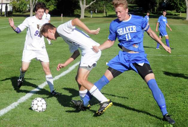 Ballston Spa's Meyer Aviles and Shaker's Thomas Jelstrom battle for the ball during their boy's soccer game on Thursday Sept. 24, 2015 in Ballston Spa, N.Y.  (Michael P. Farrell/Times Union) Photo: Michael P. Farrell / 00033475A