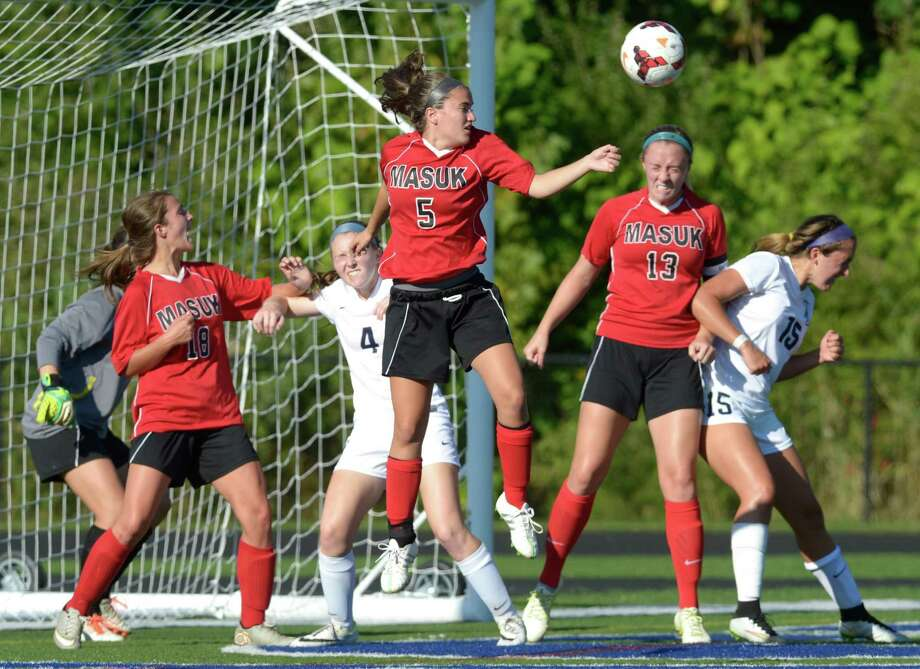 Players battle for the ball off a corner kick in front of Masuk goalie Photo: H John Voorhees III / Hearst Connecticut Media / The News-Times