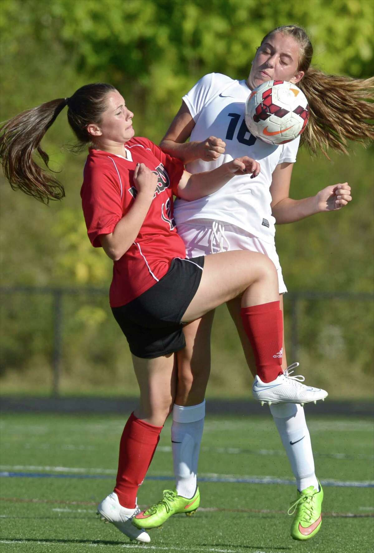 Masuk's Brooke Metcaldi (12) and Immaculate's Kinsey Jarbo battle for the bal during their game Thursday at Immaculate High School.