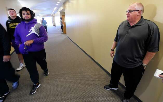 Members of the SUNY men's football team move to their next meeting as Coach Greg Gattuso, right, watches  in the renovated football offices Thursday morning Sept. 24, 2015 at the University at Albany in Albany, N.Y.     (Skip Dickstein/Times Union) Photo: SKIP DICKSTEIN / 10033489A