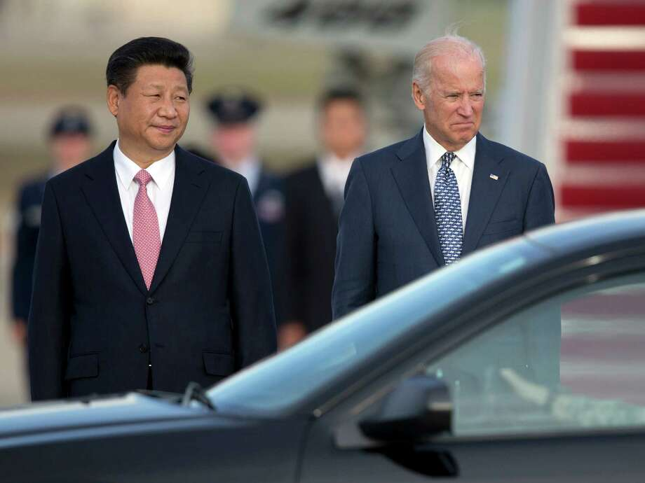 Chinese President Xi Jinping, greeted at his arrival Thursday by Vice President Joe Biden, will meet with President Barack Obama on Friday.  Photo: Carolyn Kaster, STF / AP