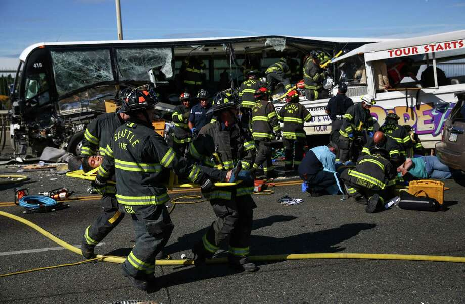Emergency personnel work at the scene of a fatal collision involving a charter bus and a Ride the Ducks amphibious tour bus on the Aurora Bridge in Seattle. Photo: Joshua Trujillo /seattlepi.com / seattlepi.com