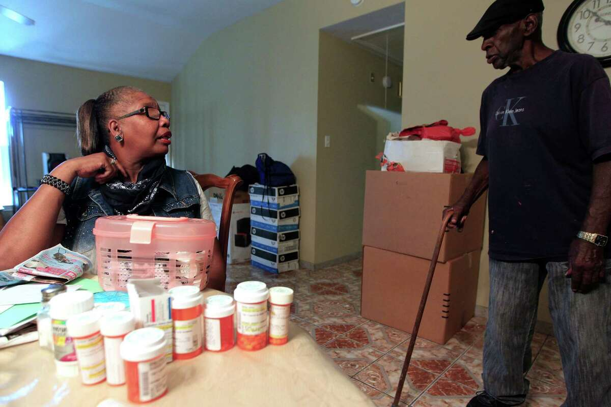 Debra Walker, a patient of Harris Health system, talks to her husband, Otis, who has prostate cancer, in their Houston home on Thursday, Sept. 24, 2015, in Houston.
