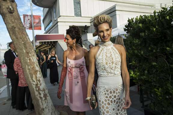 Nicole Curran (left) and Rachael Bowman walk along Grove Street to a tent set up for dinner while attending the San Francisco SymphonyÕs 2015 Opening Gala at Davies Symphony Hall in San Francisco, Calif., on Thursday, September 24, 2015.