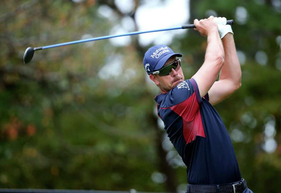 Henrik Stenson watches his tee shot on the 14th hole during the first round of the Tour Championship golf tournament at East Lake Club Thursday, Sept. 24, 2015, in Atlanta. (AP Photo/John Bazemore)  ORG XMIT: GAJB117 Photo: John Bazemore / AP