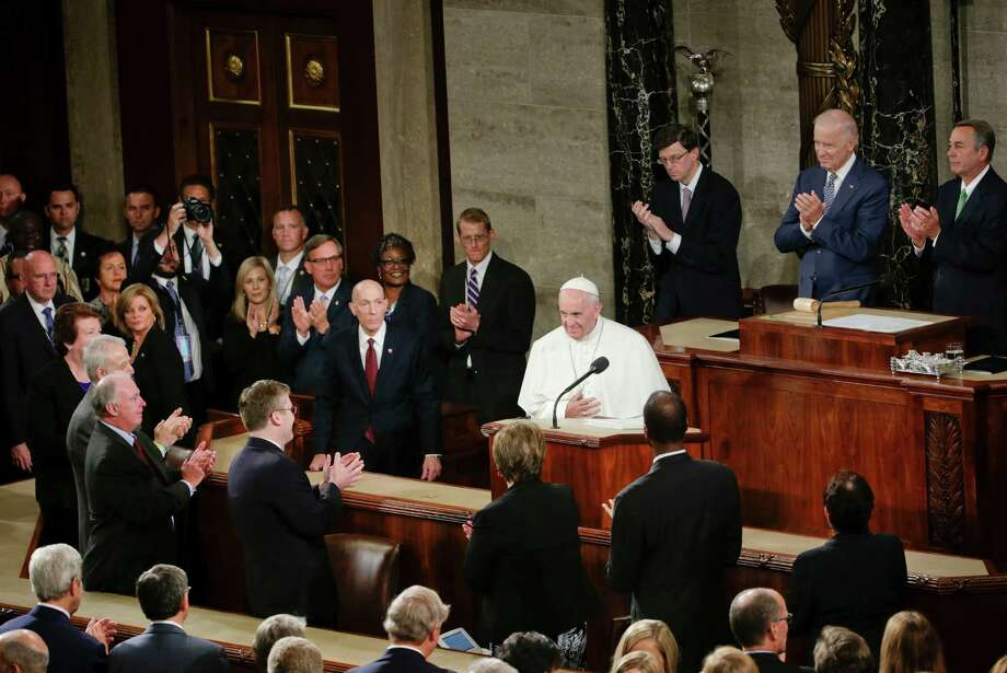 Pope Francis is applauded as he arrives on Capitol Hill in Washington, Thursday, Sept. 24, 2015, to address a joint meeting of Congress, making history as the first pontiff to do so. (AP Photo/Pablo Martinez Monsivais) Photo: Pablo Martinez Monsivais, STF / AP