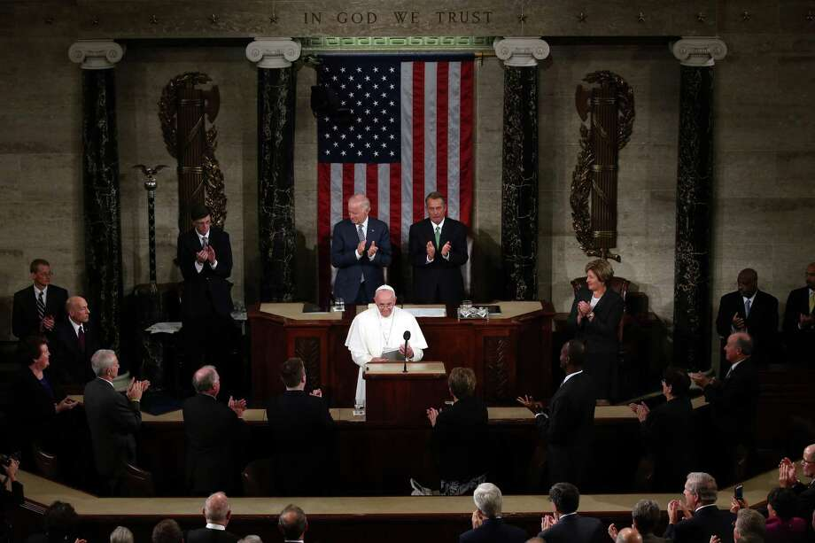 WASHINGTON, DC - SEPTEMBER 24:  Vice President Joe Biden (Top LEFT) and Speaker of the House John Boehner (R-OH) applaud Pope Francis (C) after his speech in a joint meeting of the U.S. Congress in the House Chamber of the U.S. Capitol on September 24, 2015 in Washington, DC.  Pope Francis is the first pope to address a joint meeting of Congress and will finish his tour of Washington later today before traveling to New York City.  (Photo by Mark Wilson/Getty Images) ORG XMIT: 536065697 Photo: Mark Wilson / 2015 Getty Images