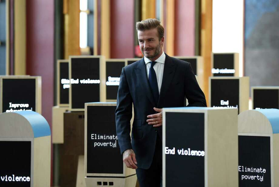 UNICEF Goodwill Ambassador David Beckham tours a installation at the United Nations General Assembly on September 24, 2015, after a press conference to announce the Assembly of Youth, a digital installation created by UNICEF.  AFP PHOTO /  TIMOTHY  A. CLARYTIMOTHY A. CLARY/AFP/Getty Images Photo: TIMOTHY A. CLARY / AFP