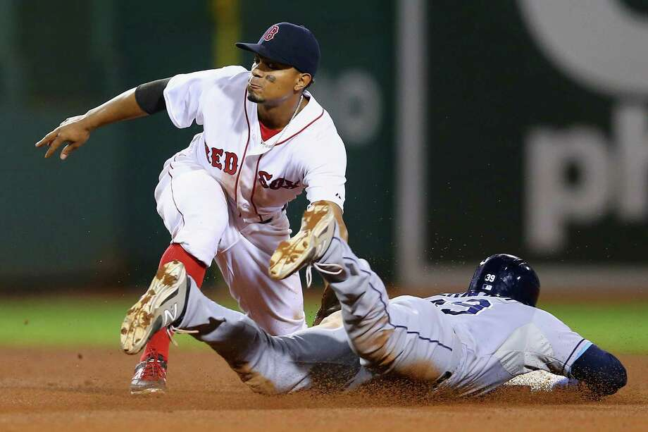 BOSTON, MA - SEPTEMBER 24:  Xander Bogaerts #2 of the Boston Red Sox tags out Kevin Kiermaier #39 of the Tampa Bay Rays during the ninth inning at Fenway Park on September 24, 2015 in Boston, Massachusetts.  (Photo by Maddie Meyer/Getty Images) ORG XMIT: 538595545 Photo: Maddie Meyer / 2015 Getty Images