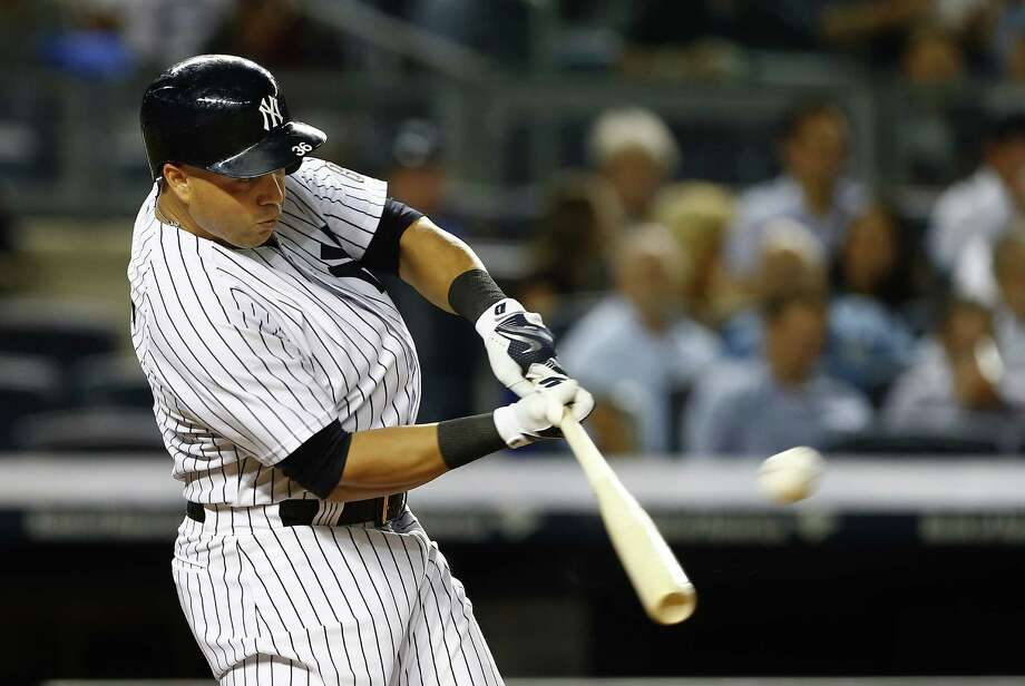 NEW YORK, NY - SEPTEMBER 24:  Carlos Beltran #36 of the New York Yankees hits a three-run home run against the Chicago White Sox during the third inning of a MLB baseball game at Yankee Stadium on September 24, 2015 in the Bronx borough of New York City. (Photo by Rich Schultz/Getty Images) ORG XMIT: 538595539 Photo: Rich Schultz / 2015 Getty Images