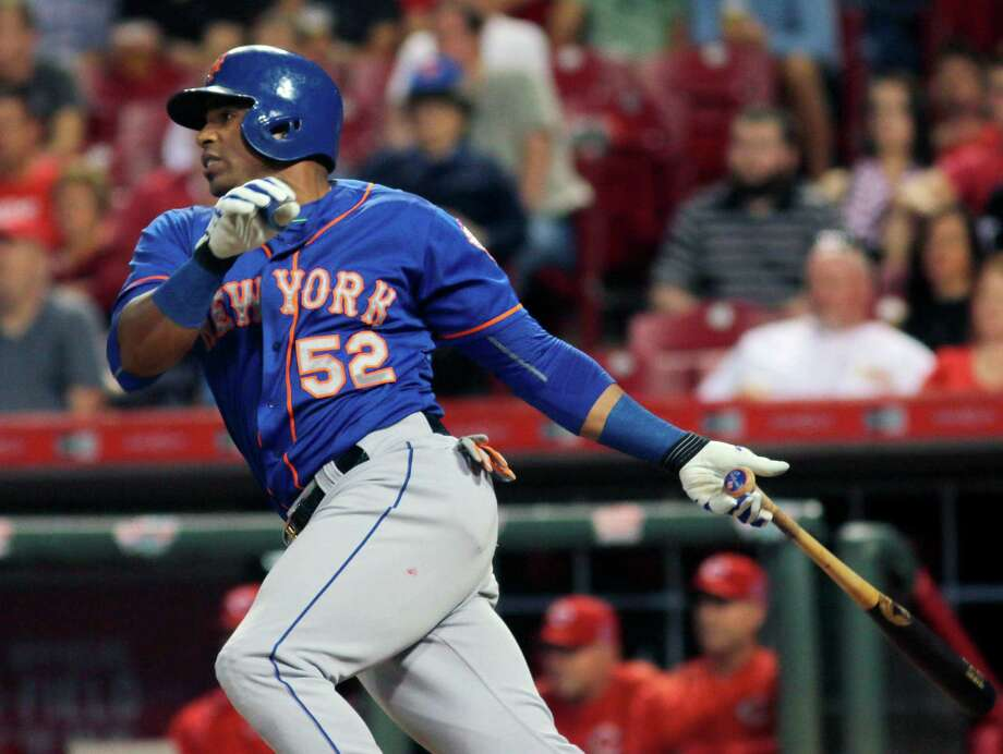 New York Mets Yoenis Cespedes hits an RBI single against the Cincinnati Reds in the seventh inning of a baseball game in Cincinnati, Thursday, Sept. 24, 2015. (AP Photo/Tom Uhlman) ORG XMIT: OHTU107 Photo: Tom Uhlman / FR31154 AP