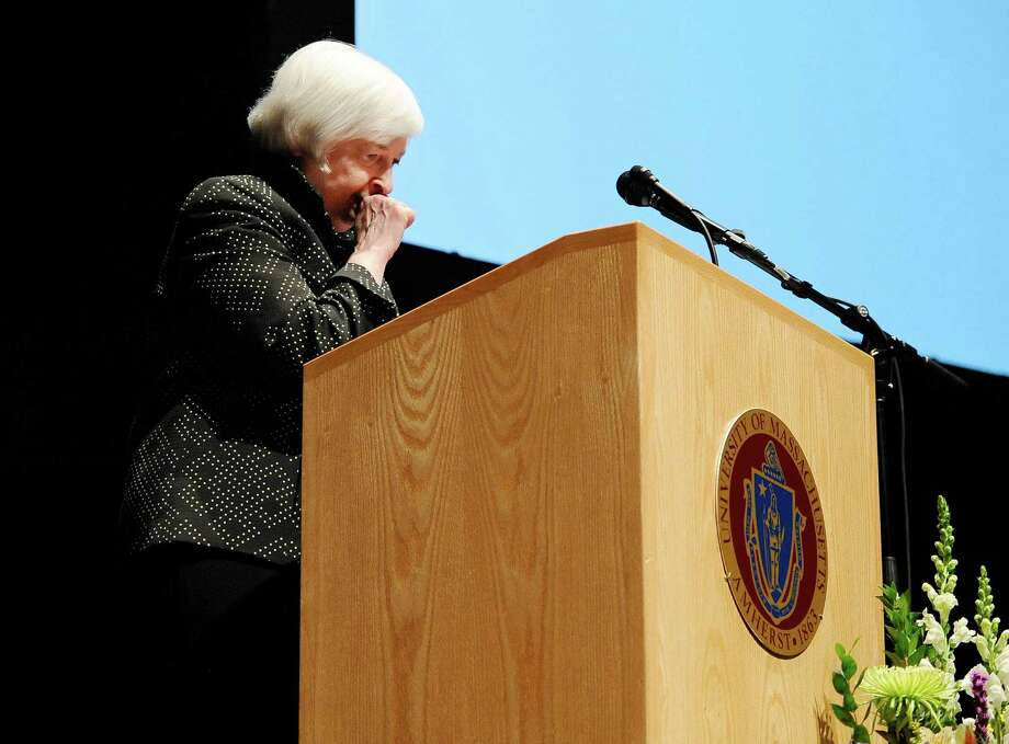 Federal Reserve Chair Janet Yellen coughs and pauses during a speech Thursday in Amherst, Mass. The Federal Reserve says Yellen felt dehydrated at the end of the speech and was seen by medical personnel as a precaution. Photo: Jessica Hill, FRE / FR125654 AP