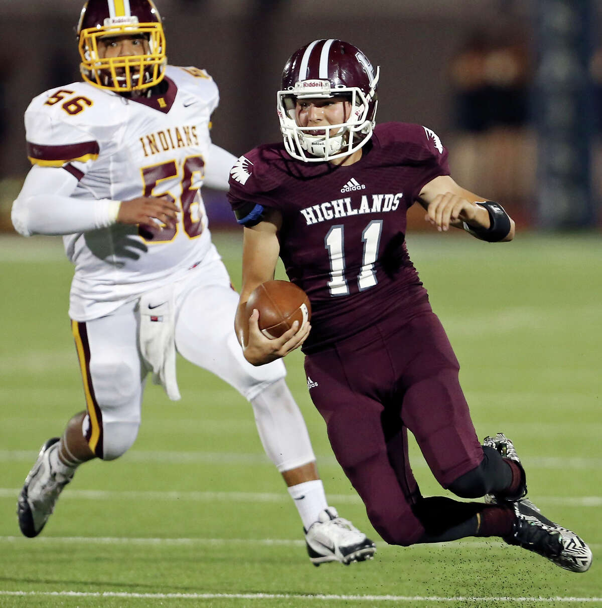 Highlands' Dylan Camacho heads up field around Harlandale's Christopher Laque during first half action on Sept. 24, 2015 at Alamo Stadium.
