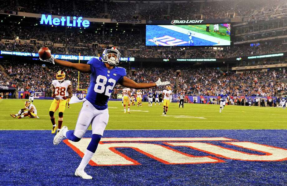 EAST RUTHERFORD, NJ - SEPTEMBER 24:  Rueben Randle #82 of the New York Giants scored a touchdown late in the fourth quarter against the Washington Redskins at MetLife Stadium on September 24, 2015 in East Rutherford, New Jersey.  (Photo by Alex Goodlett/Getty Images) ORG XMIT: 567075817 Photo: Alex Goodlett / 2015 Getty Images