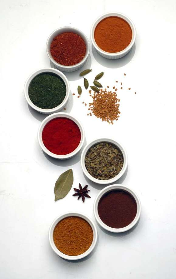 Since so many people make getting organized their New Year's resolution, your spice cabinet is a good place to start. Pictured from top, cinnamon, tandoori blend, dill, sweet Spanish paprika, fenugreek, cloves and curry, along with cardamom pods, fenugreek seeds, bay leaf and star anise. (Mark DuFrene/Contra Costa Times/MCT) Photo: MARK DuFRENE, MCT / Contra Costa Times