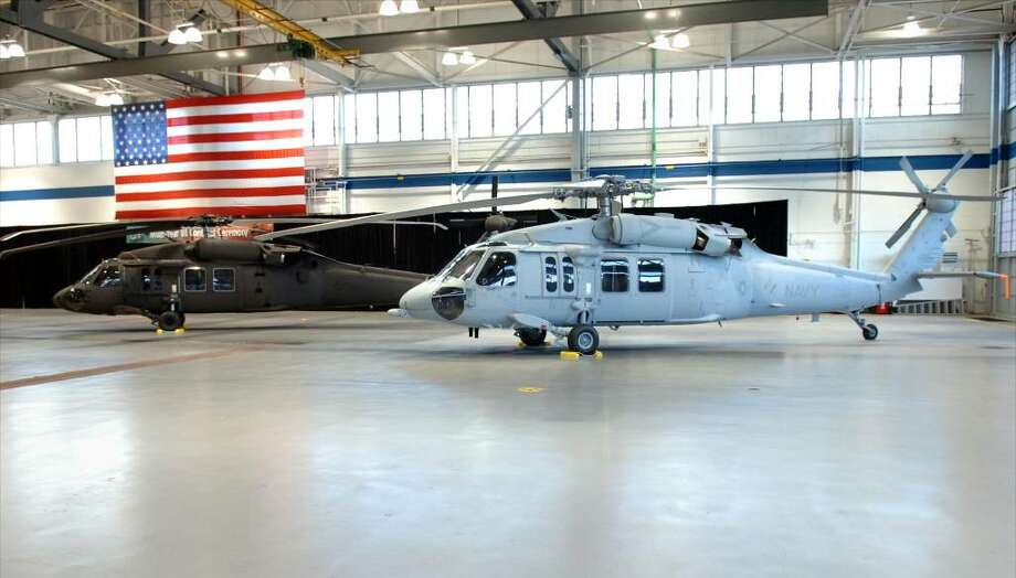 Sikorsky's UH-60M Black Hawk for the U.S. Army (left), and MH-60S Seahawk for the U.S. Navy (right), seen here in the Military Hangar at Sikorsky Aircraft in Stratford in 2008. Photo: Ned Gerard / Connecticut Post