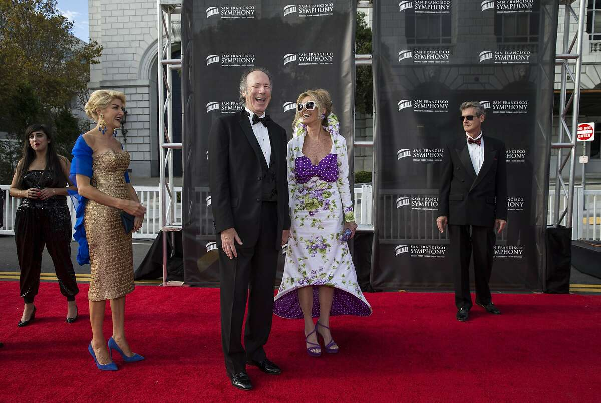 Karen Caldwell, Tom Barrett and Belinda Berry (left to right) wait on the red carpet to take photos after arriving to attend the San Francisco Symphony's 2015 Opening Gala at Davies Symphony Hall in San Francisco, Calif., on Thursday, September 24, 2015. The gala celebrated the opening of the symphony's 104th season and proceeds from the event benefit the symphony's education and community programs.
