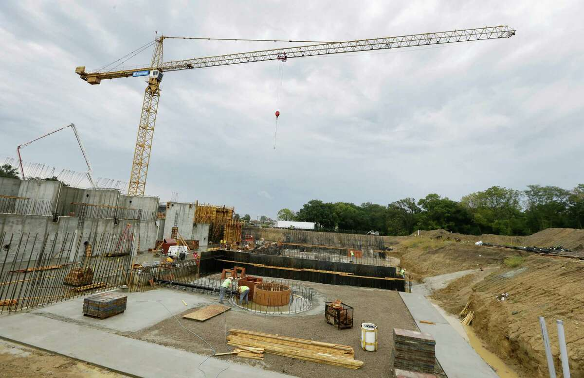 ADVANCE FOR USE SATURDAY, SEPT. 26, 2015 AND THEREAFTER - In this Thursday, Sept. 17, 2015, photo, a crane stands over the the new Ames water treatment plant in Ames, Iowa. The largest federal aid program for improving the nation's crumbling drinking water systems has provided a $76 million loan for the plant. (AP Photo/Charlie Neibergall) ORG XMIT: NY322