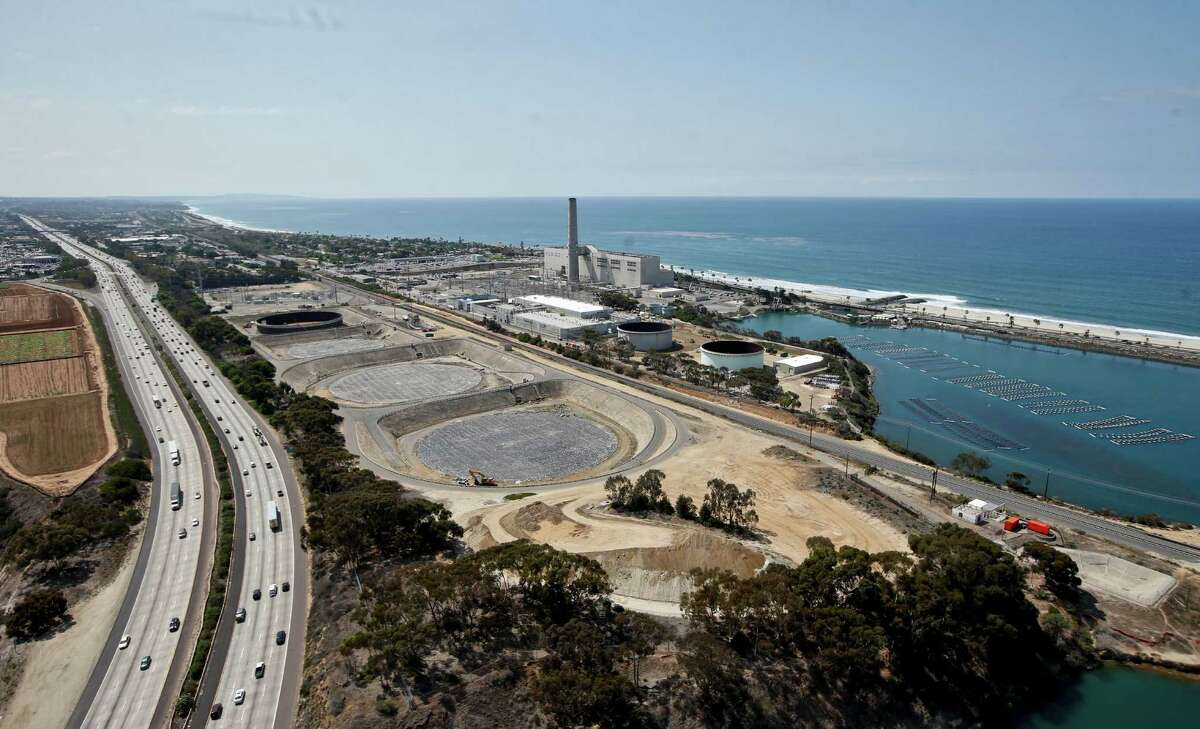 ADVANCE FOR USE SATURDAY, SEPT. 26, 2015 AND THEREAFTER - This Friday, Sept. 4, 2015, photo, shows construction of the Carlsbad, Calif., desalination plant between Interstate 5 and the Pacific Ocean. Climate change and drought have stretched water supplies from coast to coast. The vast majority of 50 state water officials surveyed by the federal government expect shortages to affect them over the next 10 years. (AP Photo/Lenny Ignelzi) ORG XMIT: NY371