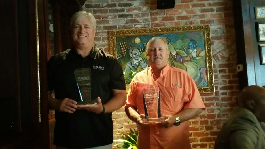 Scott McCauley and Paul Wheelington each received a 25 year award for their dedicated volunteer service as Mobiloil Credit Union board members.